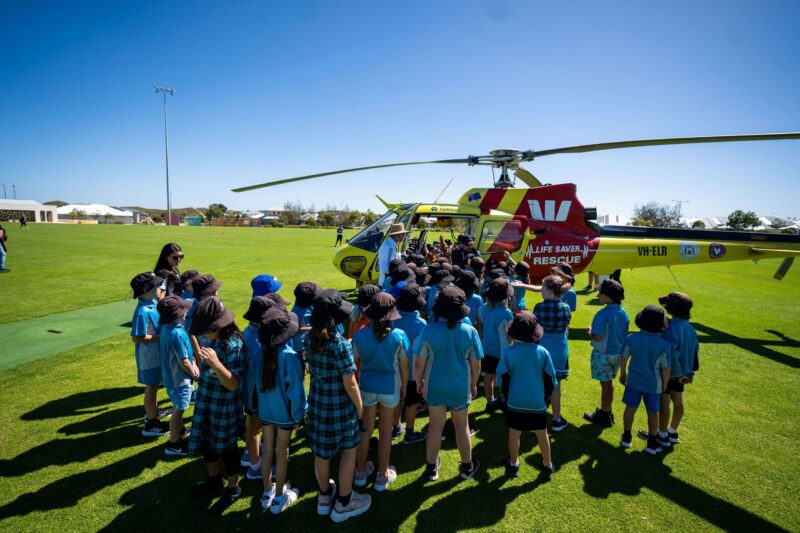 Students at Alkimos Beach Primary School held onto their hats last week as they prepared for a beach safety lesson with a difference, welcoming Surf Life Saving WA's (SLSWA) Westpac Lifesaver Rescue Helicopter to the Leatherback Oval at Alkimos Beach.