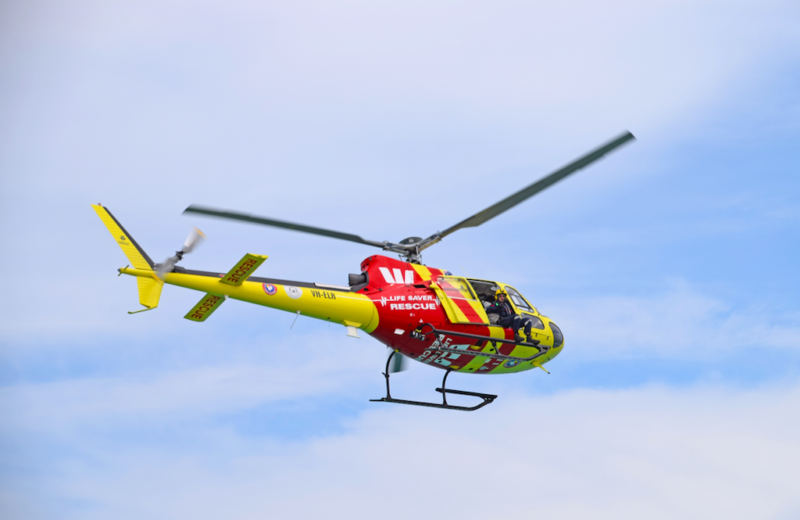Photo of Westpac Life Saver Rescue Helicopter flying over beaches